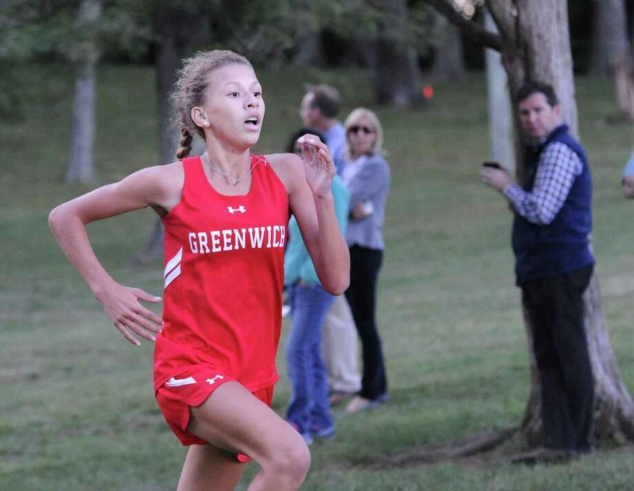 Greenwich freshman Zoe Harris finished in first place during the girls cross country meet Tuesday at Greenwich Point. The Cardinals picked up wins over Warde and Darien. Photo: Bob Luckey Jr. / Hearst Connecticut Media / Greenwich Time