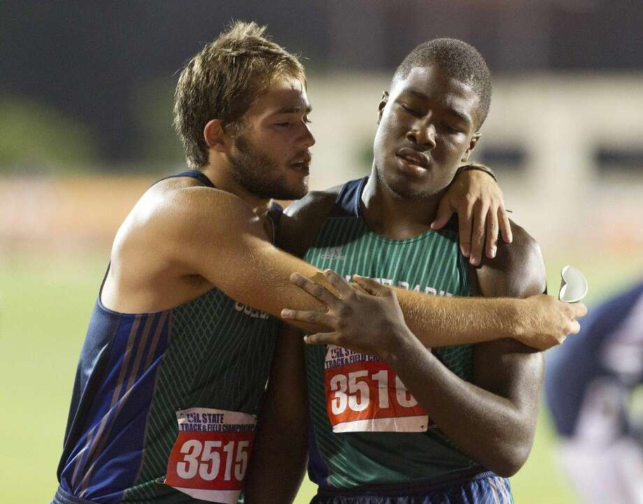 College Park's Luke Dorrough celebrates with Joshua Holman after finishing third in the 6A boys 4x400 meter relay during the UIL State Track & Field Championships Saturday at Mike A. Myers Stadium in Austin. Go to HCNpics.com to view more photos from the meet.