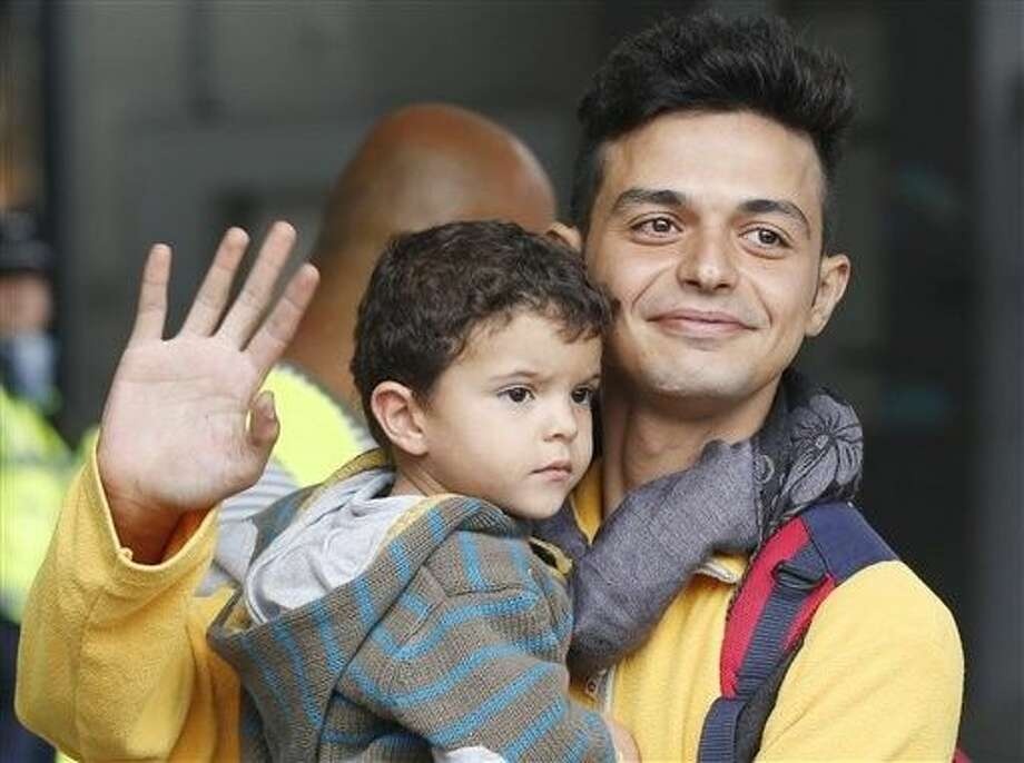 Hundreds of refugees arrived in various trains to get first registration as asylum seekers in Germany. Photo: Michael Probst