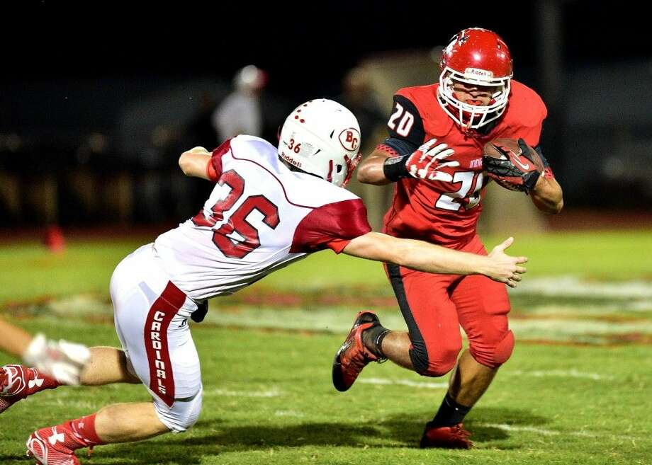 Kade Wheat (36) of the Bridge City Cardinals attempts to take down Dylan Reeves (20) of the Cleveland Indians. Photo: Submitted Photo