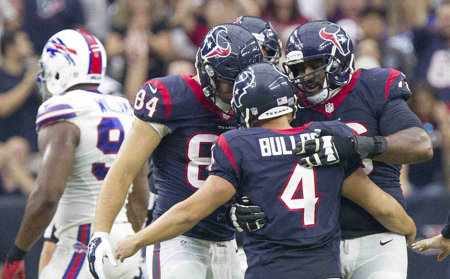 Houston Texans kicker Randy Bullock celebrates after hitting during the second half of an NFL football game Sunday, Sept. 28, 2014, in Houston. Bullock hit a 50 and 55-yard field goal in the fourth quarter to help the Texans defeated the Buffalo Bills 23-17. Photo: Jason Fochtman