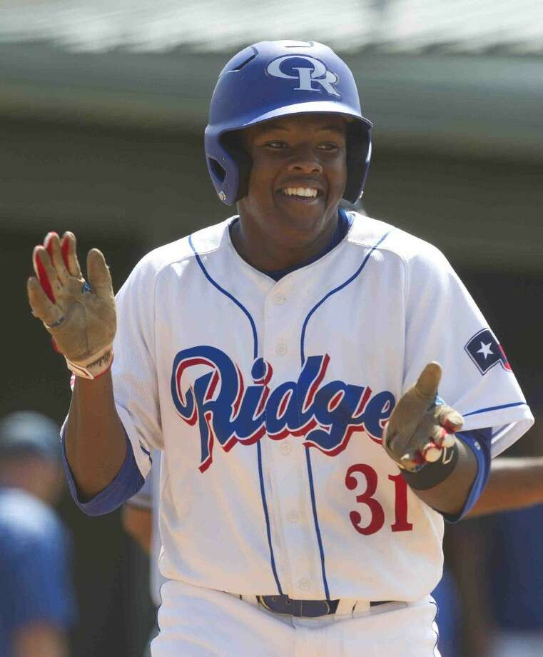 Oak Ridge's Justin Alphonse celebrates after hitting a solo home run during the fifth inning of a Region II-6A bi-district playoff game.