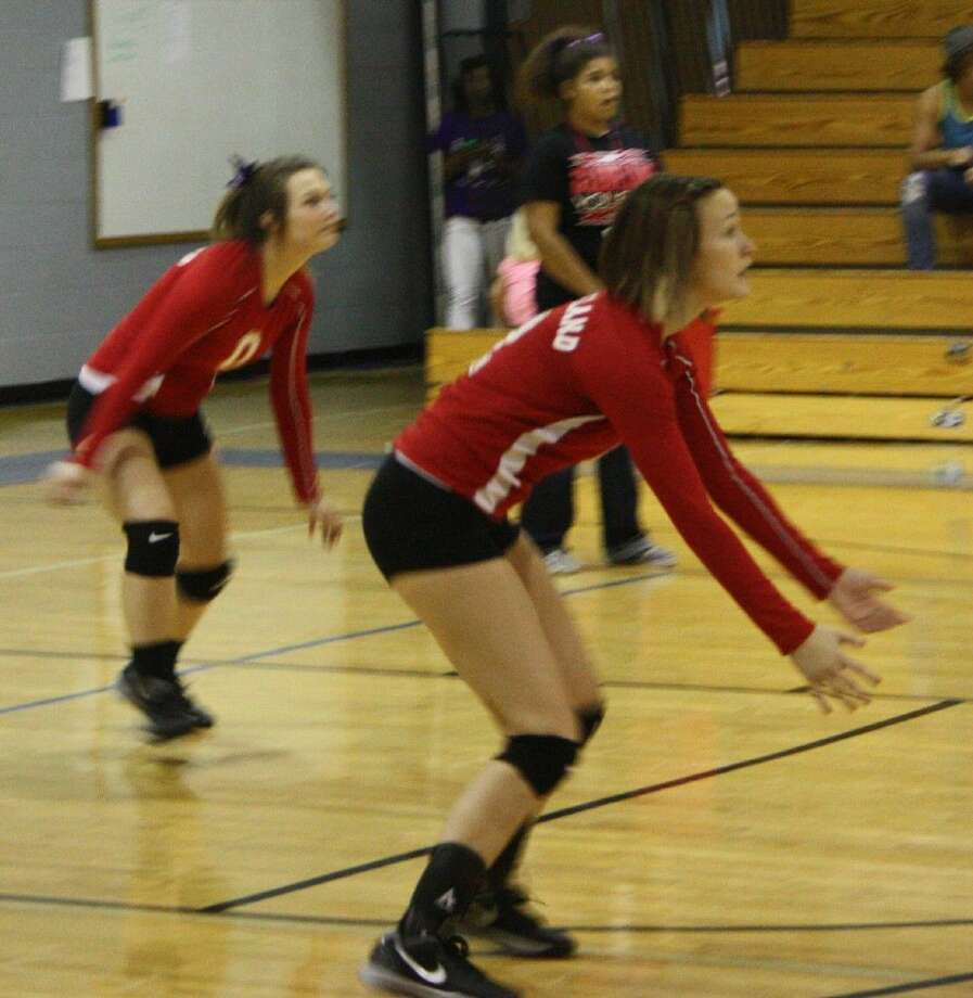 Amber Ott (2) and Morgan Concord (0) of the Lady Indians move into position to dig an incoming volleyball. Photo: Staff Photo By Jacob McAdams