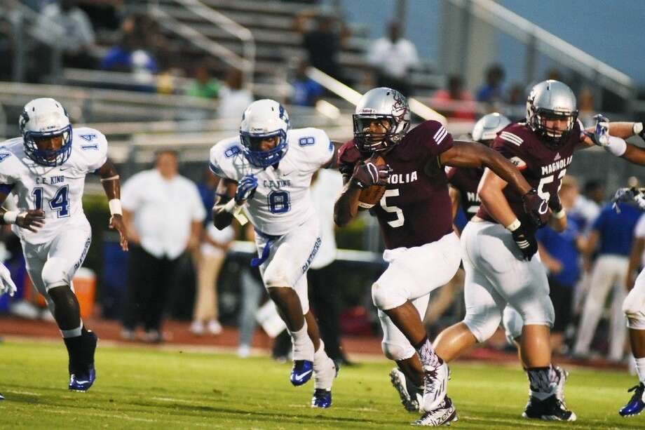 Magnolia's Anthony Johnson looks for running room against C.E. King. The Bulldogs stopped King 41-26, improving to 2-0 on the season.