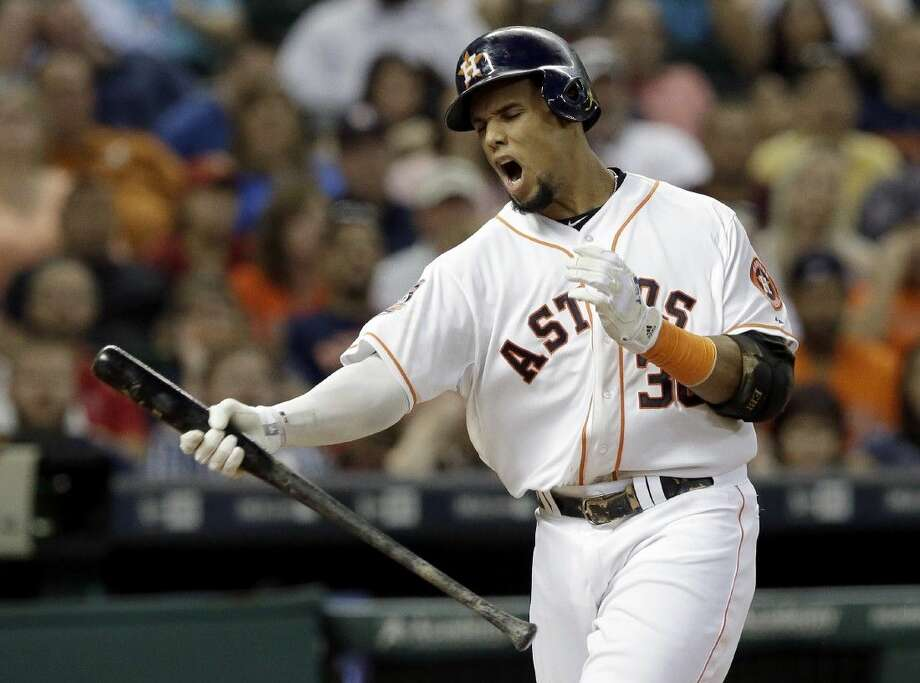 Houston Astros' Carlos Gomez yells after striking out against the Minnesota Twins in the sixth inning Saturday in Houston.