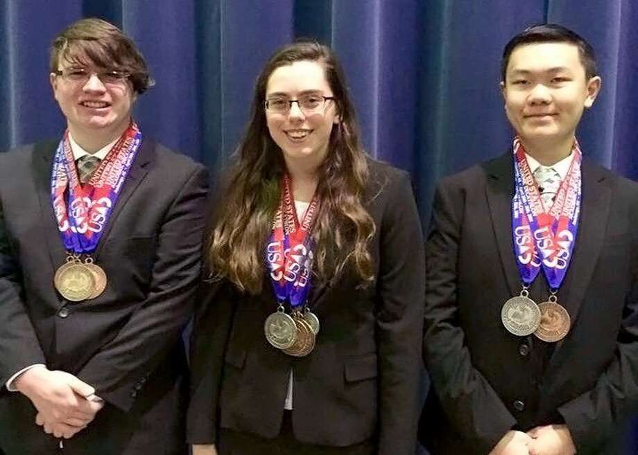 Pearland High School decathletes (from left) Mitchell Jackson, SaraBeth Matthews and Jimmy Thai collectively won 10 medals at the U.S. Academic Decathlon Nationals.