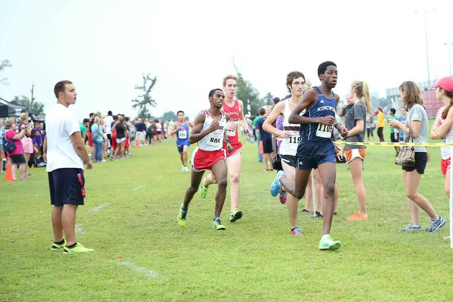 Mustang Charles Mills works his way through the pack on his way to a first place finish at the Cy Woods Invitational Saturday.