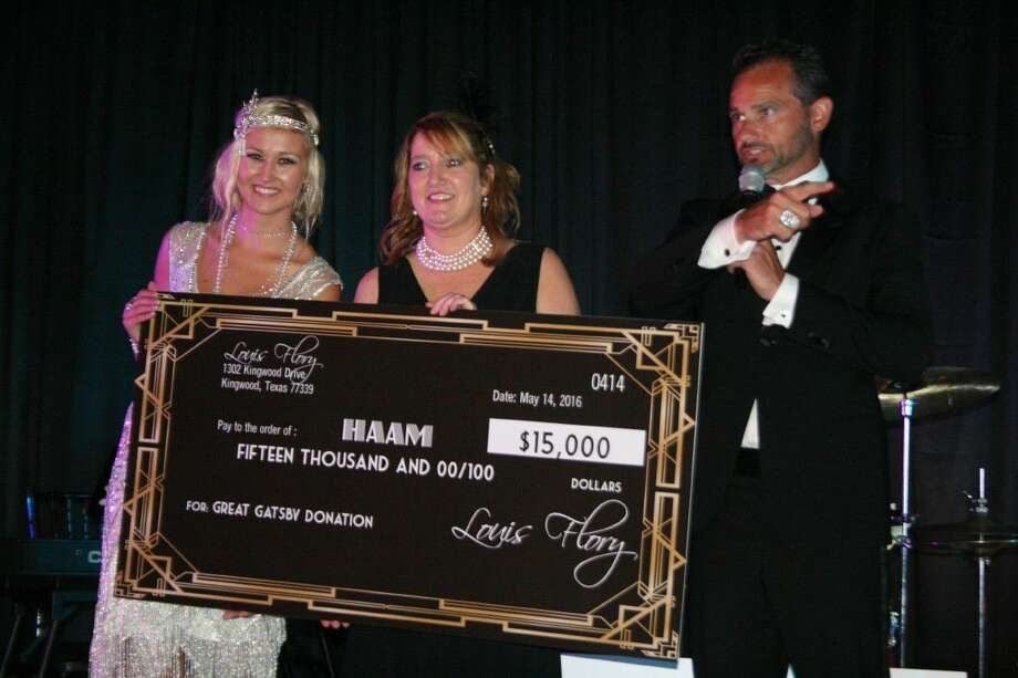 Gabrielle Stephens and Louis Flory presented a check to HAAM's Millie Garrison during their Great Gatsby-themed fundraiser Satruday, May 14, 2016.