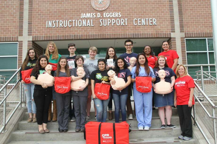 Humble ISD has received 20 CPR in Schools Training Kits from the American Heart Association. The kits will be used in high school senior classes and in seventh grade health. Showing off the new kits are students (top row, from left) Savannah Smith of Quest Early College High School, Laura Bennett of Kingwood Park High School, Dakota Haley of Kingwood Park High School, Chase Callahan of Kingwood High School, Kayleigh Farias of Kingwood Park High School, Nick Sheppard of Atascocita High School, Michelle Mason and Amanda Krippel of the American Heart Association and (front row, from left) Carmen Ruiz of Kingwood Park High School, Angelee Vaile of Kingwood Park High School, Jacqueline Holmes of Kingwood Park High School, Viviana Garcia of Quest Early College High School, Lauren Martinez of Atascocita High School, Mandy Garcia of Kingwood Park High School, Elizabeth Mathews of Atascocita High School, and Helen Wagner, Humble ISD School Health Advisory Council Facilitator.
