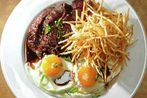 Steak and eggs with shoestring fries at Swoon Kitchenbar in Hudson Friday July 29, 2011.  (John Carl D'Annibale / Times Union)