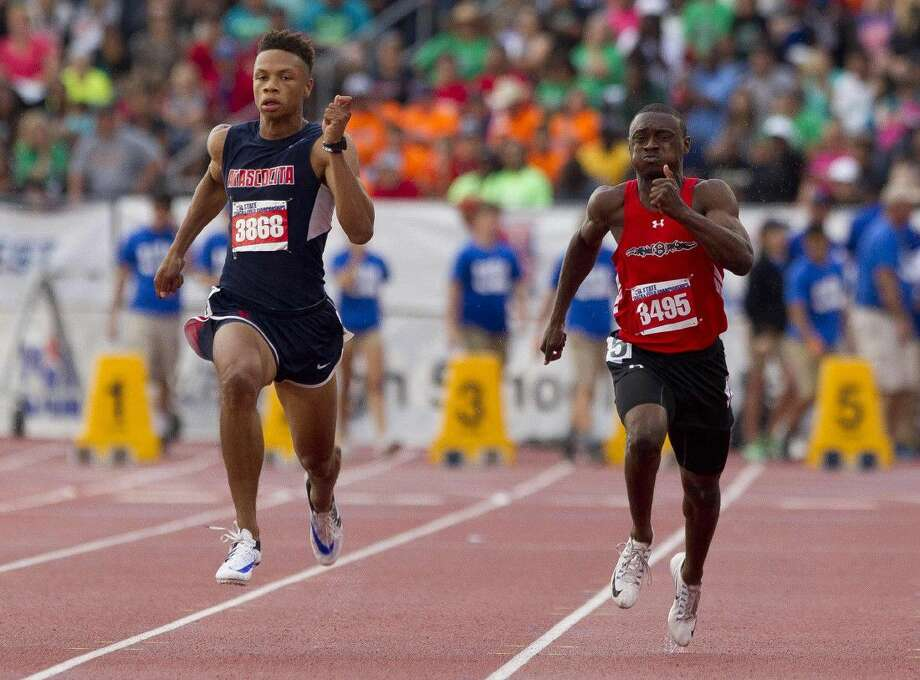 Atascocita's Jace Comick and Clear Brook's Brandon Taylor compete in the 6A boys 100-meter dash during the UIL State Track & Field Championships Saturday at Mike A. Myers Stadium in Austin. Go to HCNpics.com to view more photos from the meet. Photo: Jason Fochtman