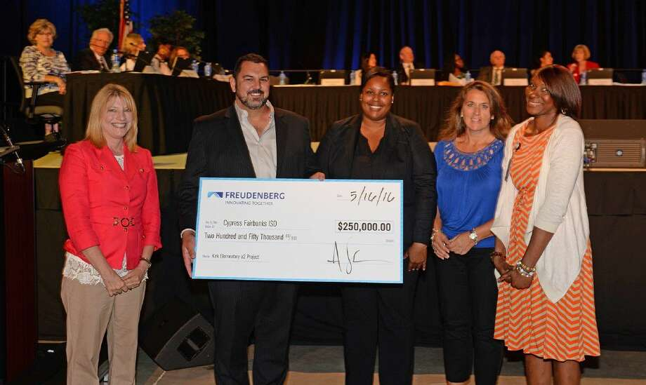 Representatives from Freudenberg/EagleBurgmann present a 250,000 check to CFISD and Kirk Elementary School during the May 16 Board of Trustees meeting at the Berry Center. Pictured (L-R) are Lynda Zelenka, executive director of Cy-Hope; Aaron Johnson, managing director of EagleBurgmann USA; Stephanie Wade, EagleBurgmann USA health, safety and environment manager; Donna Butler, EagleBurgmann USA sales business manager; and Onica Mayers, Kirk principal.