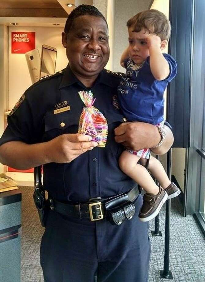 Andres E Jimenez, son of Carminia Y'Eloy Jimenez of Cleveland, is held in the arms of Cleveland Police Chief Darrel Broussard after Jimenez's family delivered the chief a treat to say thank you for his service to the community. Photo: Submitted