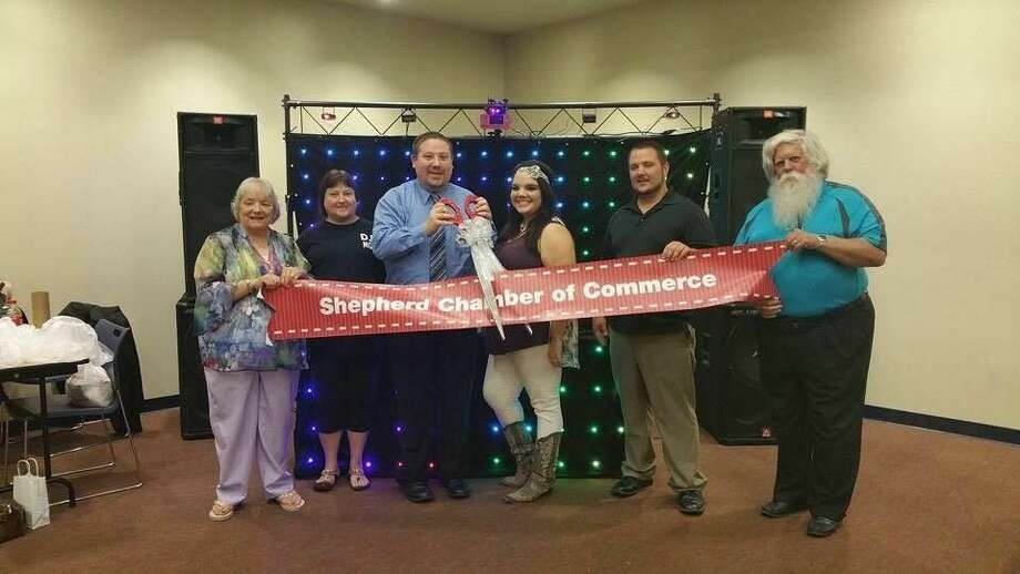"Jimmy Enloe (third from left) has been a member of the Shepherd Chamber of Commerce for a brief amount of time, but his membership was made official on Aug. 29 with a ribbon cutting ceremony at the Baby, Kid and Family Expo hosted at the Cleveland Civic Center. Pictured left to right are Yvonne Ryba, Jewline Enloe, Enloe, Melody Burton, Cody Perry and Pct. 2 Judge Harris ""Red"" Blanchette. Photo: Jacob McAdams"