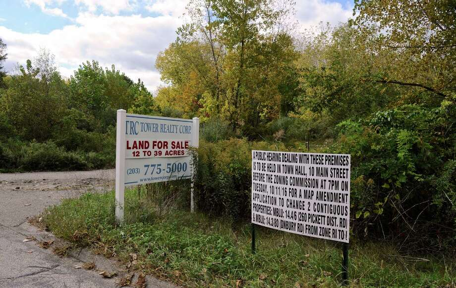 Land For Sale and public hearing announcement signs on Pickett District Road. A zoning amendment has been proposed for 39.5 acres of land between Pickett District Road and Old State Road/Danbury Road in New Milford. Tuesday afternoon, October 4, 2016, in New Milford. Conn. Photo: H John Voorhees III / Hearst Connecticut Media / The News-Times