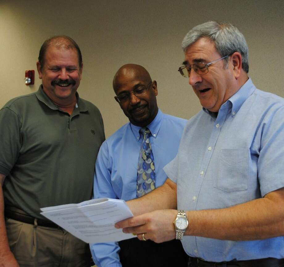 Shrimporee Chairman John Branch, right, shares a light moment with fellow Rotarians Bill Taylor, left, and Darryl Smith as they plan the annual feast for the community Oct. 25 in Clear Lake Park.