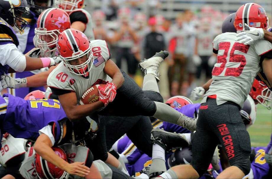 New Canaan's J.R. Moore (40) dives in for first-half touchdown against Westhill in a football game at J. Walter Kennedy Stadium in Stamford on Saturday. New Canaan defeated Westhill 35-7. Photo: Matthew Brown / Hearst Connecticut Media / Stamford Advocate