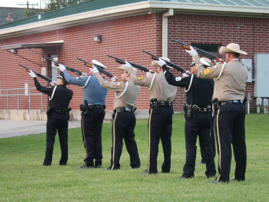 The Liberty County Honor Guard, comprised of peace officers from various agencies in the county, performed a 21-gun salute at the conclusion of a law enforcement memorial service. The service was scheduled for National Police Week, May 11-17. Photo: Vanesa Brashier