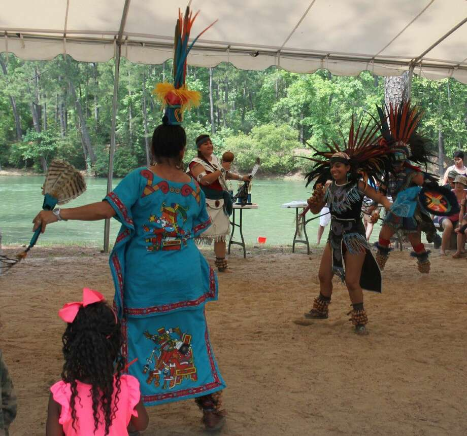 The Aztec Dancers show their moves at the Hug-a-Tree/Kiss-a-Fish event at the Artesian Lakes Resort on May 14. Photo: Jacob McAdams