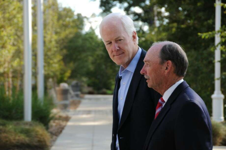 Ray Laughter, right, pictured with U.S. Sen. John Cornyn when the senator paid a visit to the LSC-Conroe Center, is set to retire as Lone Star College vice chancellor of external affairs. Photo: Submitted Photo