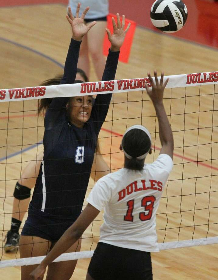 Clements' Holai Johnson tries to block Dulles' Noelle Buchanan during a District 23-6A volleyball game Sept. 23 at Dulles High School in Sugar Land. To view or purchase this photo and others like it, go to HCNPics.com. Photo: Staff Photo By Alan Warren