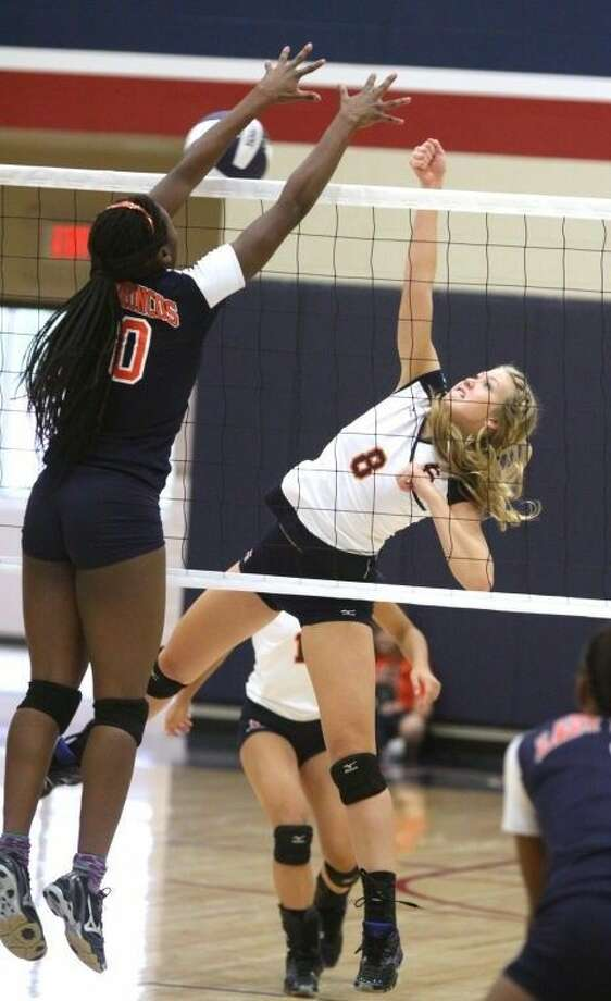 Aubreye Reddell and Seven Lakes defeated Cinco Ranch to take sole possession of first place in District 19-6A. The Lady Spartans improved to 4-0. Photo: Alan Warren