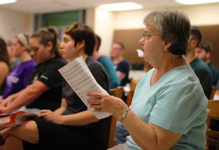 Community Chorus member Kathryn Speer rehearses songs from Handel's Messiah.