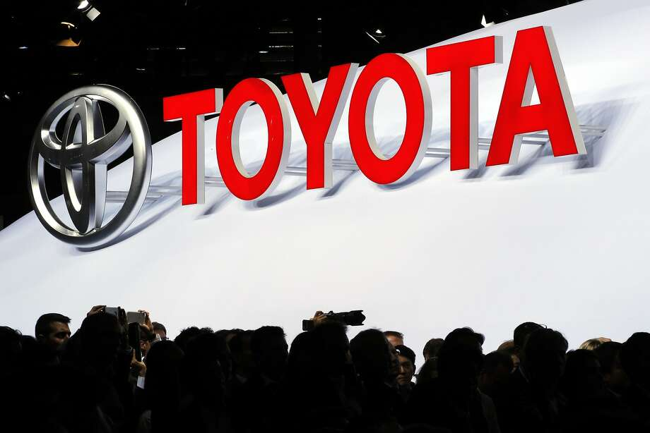 The logo of Japanese car manufacturer Toyota is displayed behind members of the media Toyota at the Paris Auto Show in Paris, France, Thursday, Sept. 29, 2016. The Paris Auto Show will open its gates to the public from Oct. 1st to 16th. (AP Photo/Christophe Ena) Photo: Christophe Ena, Associated Press