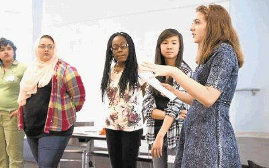 Young women discuss things like global issues, human rights, self-esteem, leadership and conflict resolution during Pangea Network's Young Women Leadership's Camp in Houston. The camp is offered July 18-23 at Rice University.