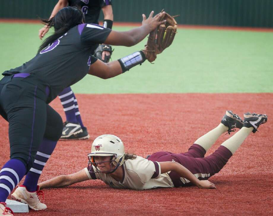Magnolia West's Lacey Sanders (3) steals third base during the high school softball game against Willis on Monday at Madisonville High School. To view more photos from the game, go to HCNPics.com.