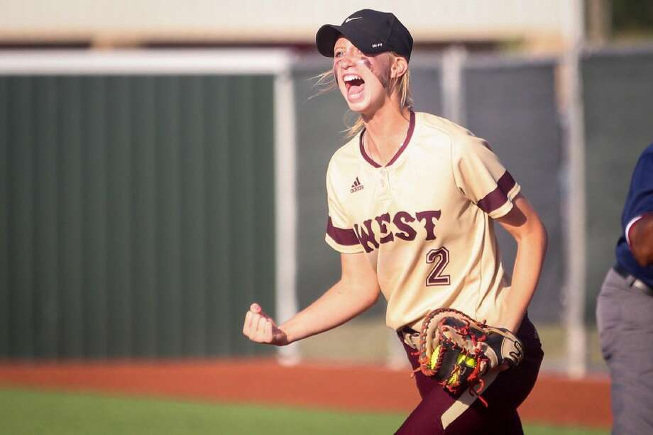 Magnolia West's Katilyn Goike (2) reacts after a successful play during the high school softball game against Willis on Monday, May 16, 2016, at Madisonville High School. To view more photos from the game, go to HCNPics.com.