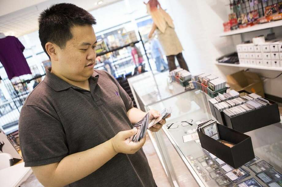 Steve Shen browses through the shops collection of Magic: The Gathering cards at Allstar Comics & Games on Sep. 5, 2015, at Deerbrook Mall in Humble. Allstar hosts many meetups throughout the week including Yu-Gi-Oh! and Super Smash Brothers. Photo: ANDREW BUCKLEY