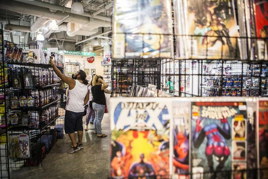 Customers looks through aisles of comics and collectables at Allstar Comics & Games on Sep. 5, 2015, at Deerbrook Mall in Humble. Photo: ANDREW BUCKLEY