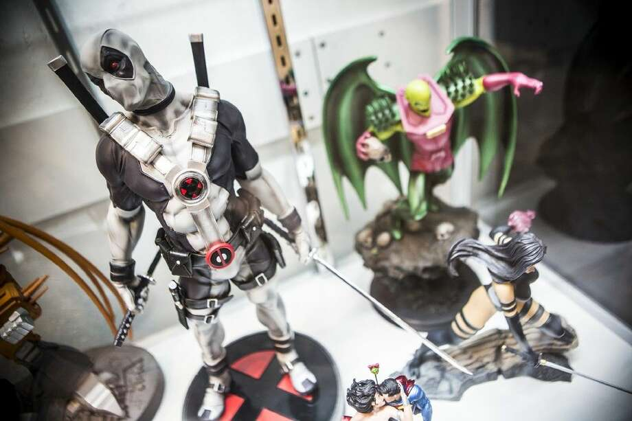 An X-Force Deadpool statue is displayed among the shop's collection of figures at Allstar Comics & Games on Sep. 5, 2015, at Deerbrook Mall in Humble. Only 1,500 statues have been created. Photo: ANDREW BUCKLEY