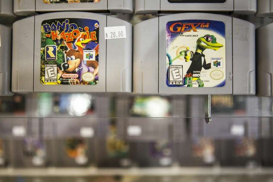 Nintendo 64 games are displayed at Allstar Comics & Games on Sep. 5, 2015, at Deerbrook Mall in Humble. Photo: ANDREW BUCKLEY