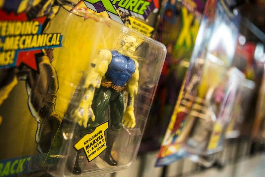 Action figures from the 1990's are displayed for sale at Allstar Comics & Games on Sep. 5, 2015, at Deerbrook Mall in Humble. Much of the merchandise for sale comes from trades from customers. Photo: ANDREW BUCKLEY