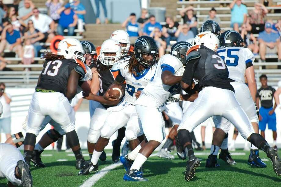 Clear Springs' Adrion Smith (28) picks his way through the Dobie defense Saturday. Photo: KIRK SIDES