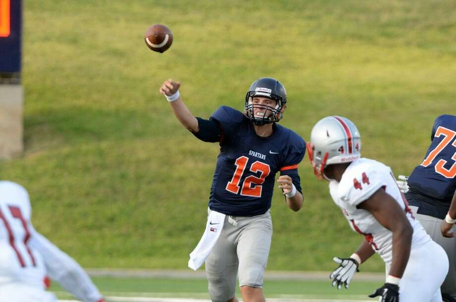 Seven Lakes quarterback Dalton Wood completed two touchdown passes in a 31-23 victory against Fort Bend Austin, Sept. 4 at Mercer Stadium. The Spartans close non-district play Sept. 10 against Clear Falls at Rhodes Stadium. Photo: Craig Moseley