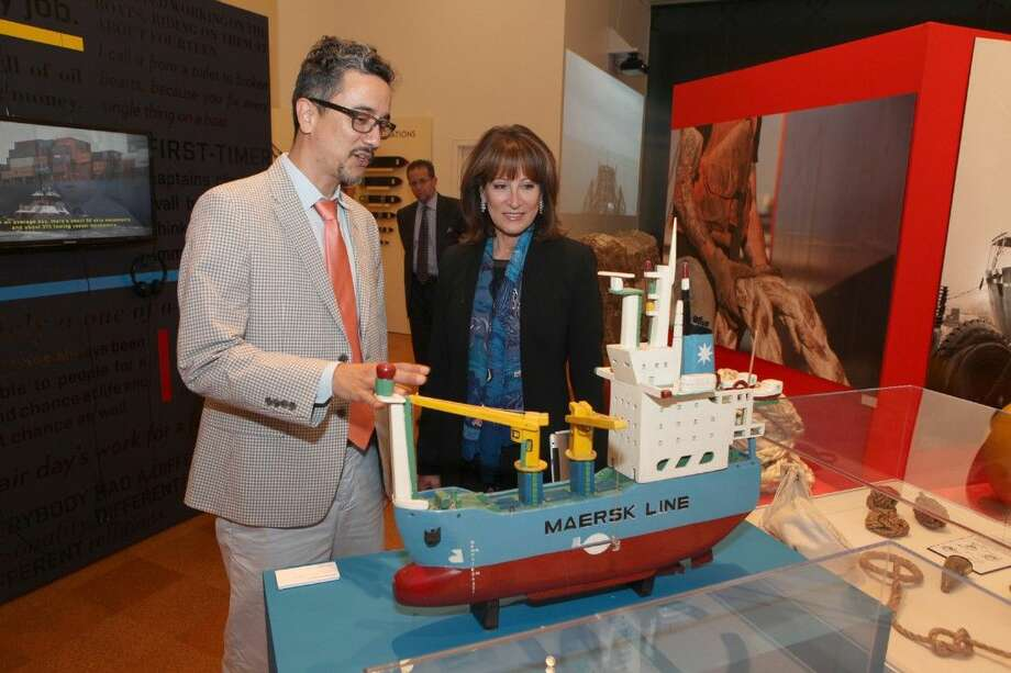 Angel Quesada, Program Associate of Folklife and Traditional Arts of Houston Arts Alliance and Janiece Longoria, Chairman of the Port Commission of the Port of Houston Authority, look at a Maersk Ship Model made out of driftwood by Frenchie Macip at the new exhibition, Stories of a Workforce: Celebrating the Centennial of the Houston Ship Channel at Julia B. Ideson Library in Houston on Tuesday, September 23, 2014. To view or purchase this photo and others like it, go to HCNPics.com. Photo: Staff Photo By Alan Warren