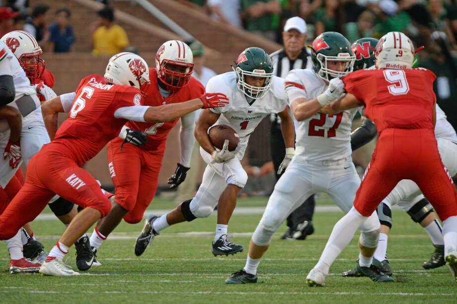 Katy's Corey Bethley (7) chases The Woodlands' Christopher Stewart during their non-district game Sept. 11 at Rhodes Stadium in Katy. Bethley has been nominated for the 2017 U.S. Army All-American Bowl. To view or purchase this photo and others like it, visit HCNpics.com. Photo: Craig Moseley