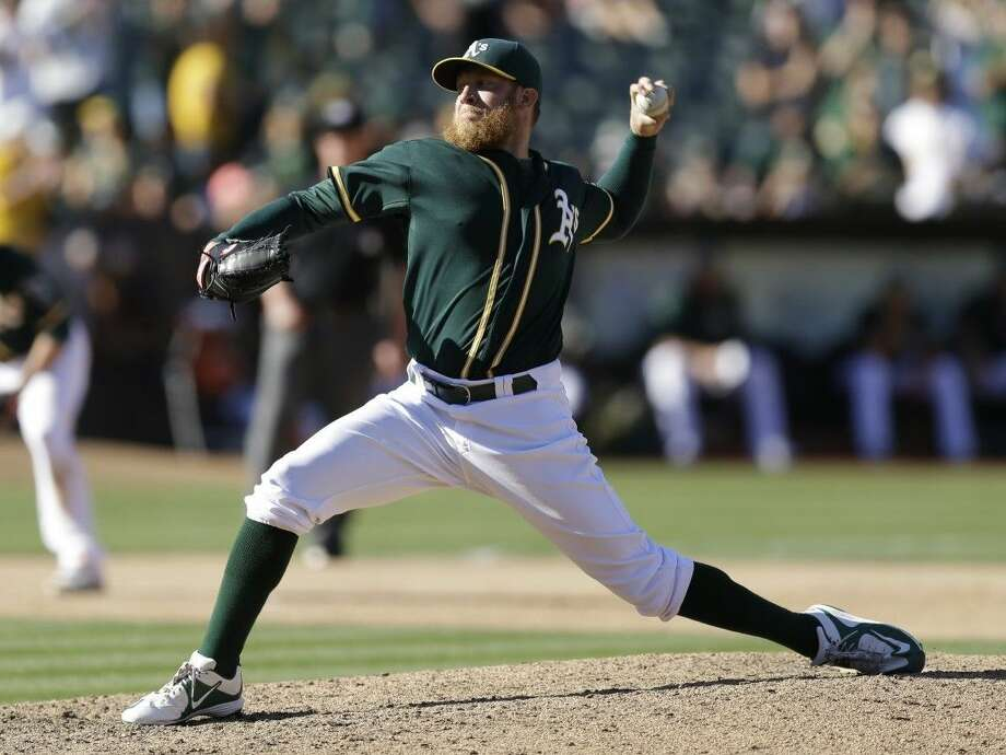 Athletics pitcher Sean Doolittle has been traded to the Nationals along with fellow reliever Ryan Madson.