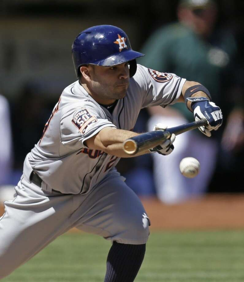 Astros second baseman Jose Altuve bunts against the Athletics. The Astros lost Monday's series opener in Oakland, falling 10-9 to the A's.