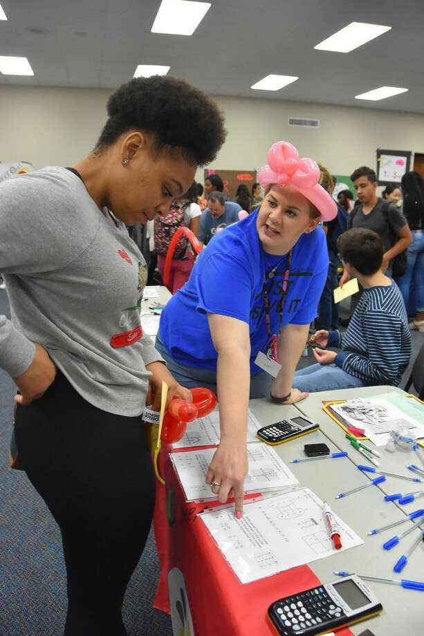 Cypress Creek High School algebra team leader Christi Robertson assists freshman Shoshanah Davis with a problem at the school's algebra carnival on April 29 in the school's LGI 1. The carnival helped prepare students for upcoming STAAR Algebra I assessments. Photo: Submitted Photo