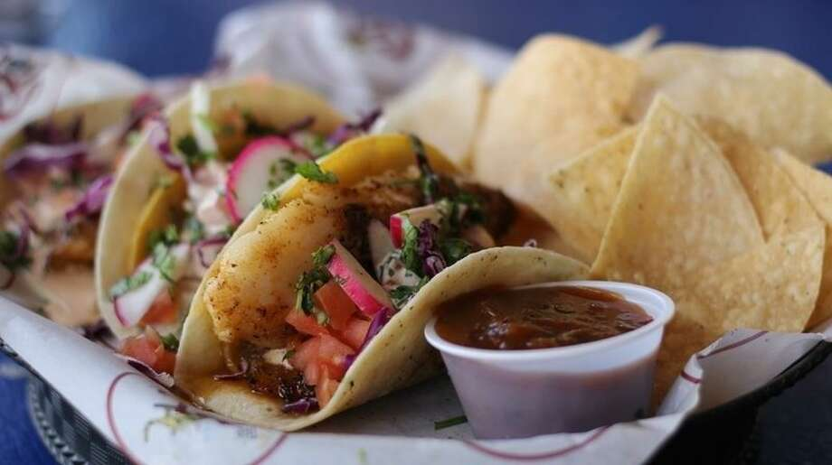 The Blackened Fish Tacos at The Spot are shredded cabbage, cilantro, Baja sauce, and pico de gallo. Served with chips and salsa. Photo: Courtesy Photo
