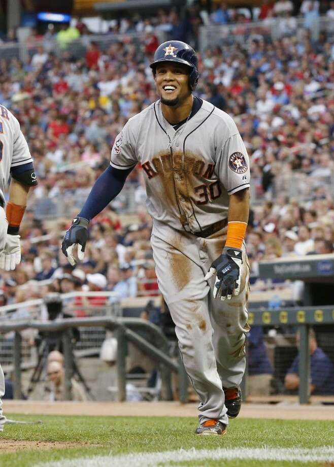 Houston Astros' Carlos Gomez scores on a two-run double by Luis Valbuena off Minnesota Twins pitcher Mike Pelfrey in the fourth inning Saturday in Minneapolis.
