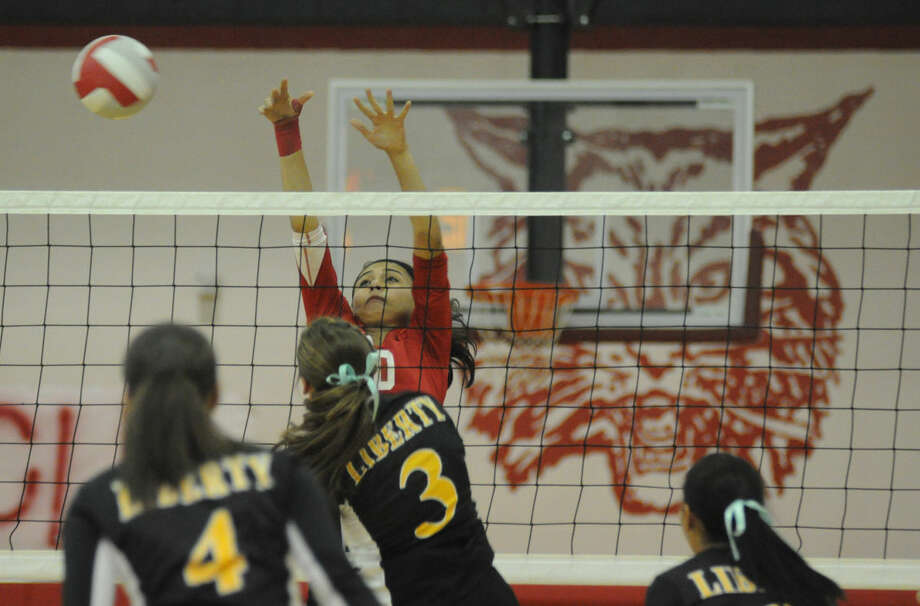 Splendora's Zoe O'Steen tips the ball against Liberty in a District 23-4A match on Tuesday at Splendora High School Photo: Keith MacPherson