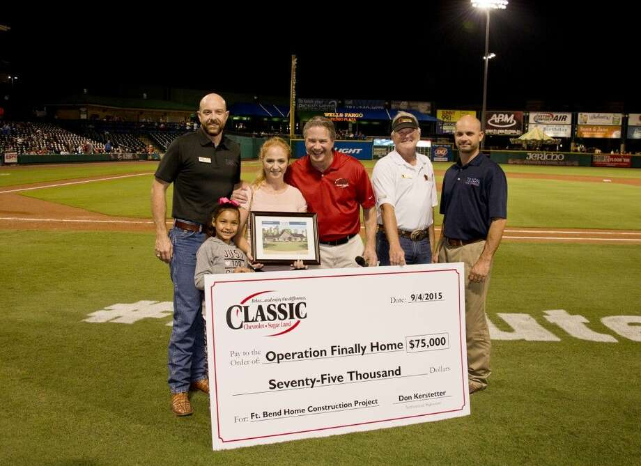 From left, Tilson Homes' Eric Alarid, Aylani Landry, Kathleen Landry, Classic Chevrolet Sugar Land's Don Kerstetter, Operation Finally Home's Lee Kirgan and Tilson Homes' Justin Ordeneaux present check to the Landrys prior to the September 5 Skeeters game at Constellation Field. Photo: BRUCE GLASS