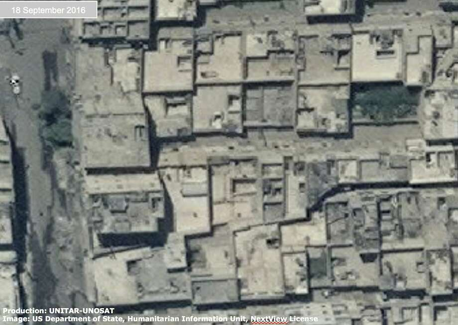 This satellite images shows destroyed homes — presumably by air strikes — in rebel-held areas of the northern city of Aleppo, The U.N. estimates 275,000 people are trapped in a government siege. Photo: Uncredited, Associated Press