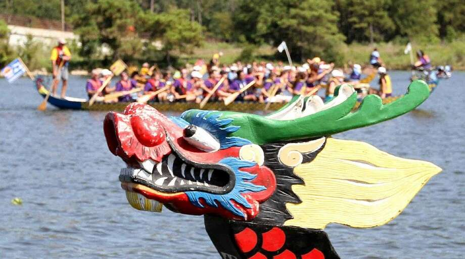 Teams race 40-foot long dragon boats during opening day of the annual YMCA Dragon Boat Team Challenge at Northshore Park. This years challenge is Sept. 24-27. Photo: Staff Photo By Jason Fochtman