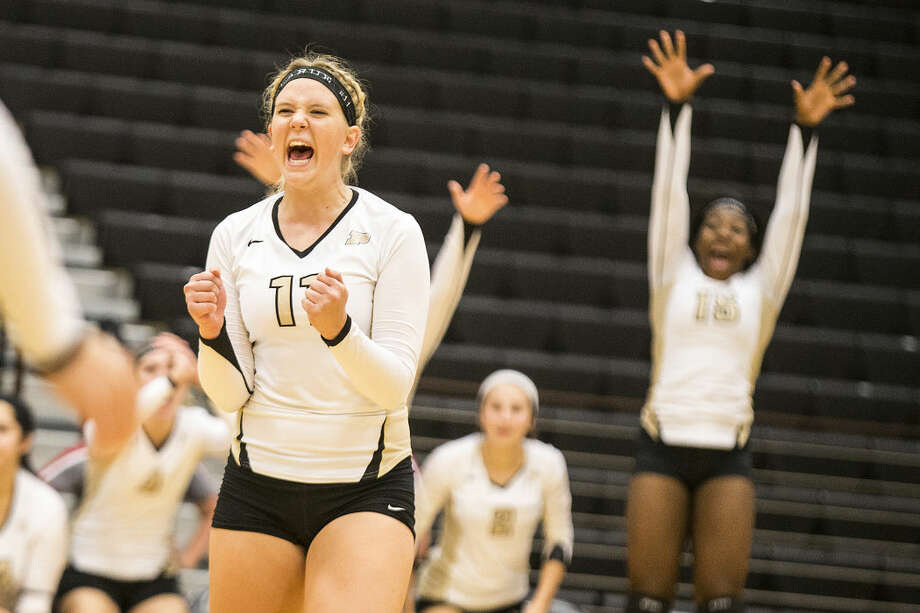 Porter's Kayla LaRue (11) celebrates after a point during Porter's 3-0 victory over Humble on Sep. 8, 2015, at Porter High School. Photo: ANDREW BUCKLEY